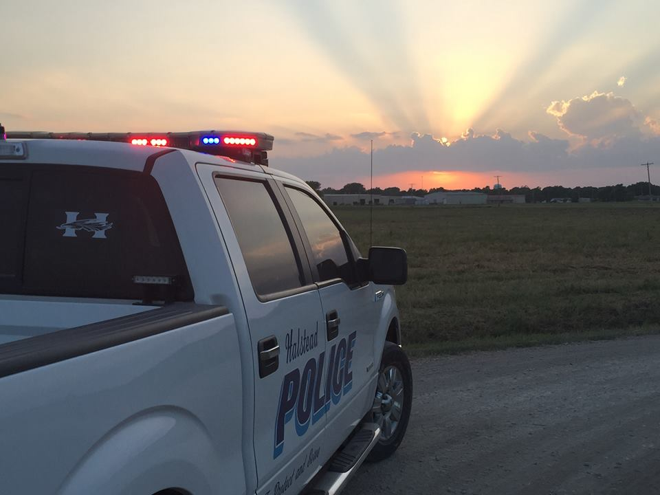 A police department truck pictured at sunrise.